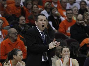 BGSU coach Curt Miller applauds his team.