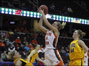 Central Michigan's Kailha Szunko hits the floor as BGSU's Jen Uhl drives to the basket.