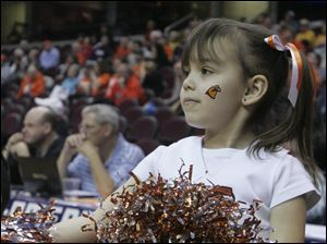 Molly Prochaska, 5, of Kingston, Ohio, watches her older cousin, BGSU player Lauren Prochaska, during the second half.