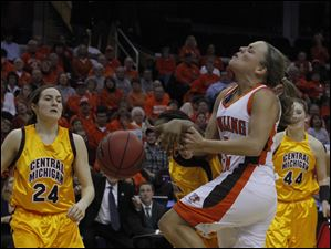 BGSU's Tracy Pontius gets the ball knocked out of her hands by a Central Michigan defender.