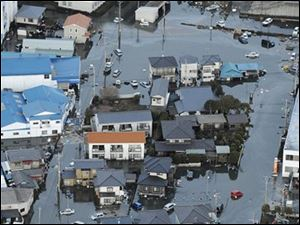 The town of Oarai is submerged after a tsunami in Ibaraki prefecture (state), Japan, Friday, March 11, 2011.