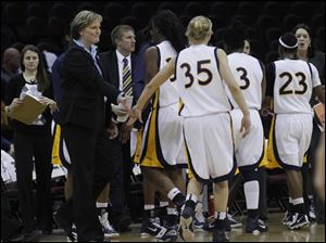 Toledo coach Tricia Cullop greets her team, including junior Haylie Linn (35).
