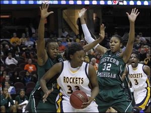 Toledo's Yolanda Richardson is sandwiched by Eastern Michigan's Kristin Thomas (25) and Paige Redditt.