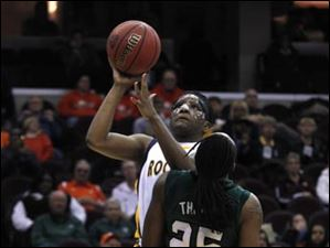 Eastern Michigan's Kristen Thomas (25) tries to take a charge from Toledo's Lecretia Smith.