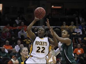 Toledo senior Andola Dortch drives through Eastern Michigan defenders.