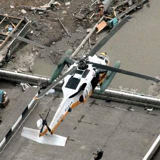 Japan-Aftermath-Minamisanrikucho-helicopter-roof-rescue