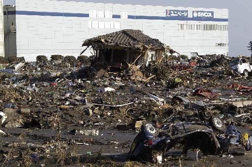 Japan-Aftermath-Sendai-Port-collapsed-house-undefined