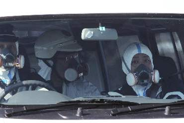 Japan-Aftermath-officers-masks-nuclear-plant