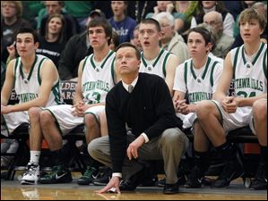 Ottawa Hills' head coach John Lindsay watches the action.