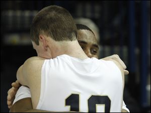 St. John's players Nick Felhaber (10) and Tarvis Malone console each other after losing to Central Catholic.