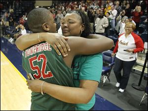 Central Catholic player Keith Towbridge, gets a hug from his mother Felicia Towbridge after the Fighting Irish defeated St. John's.