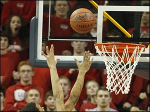 Central Catholic's DeShone Kizer, left, puts up a shot against St. John's player Marc Loving during the fourth quarter.