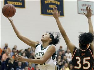 Start's Azia Bishop (50) goes to the net against Middleburg Heights Midpark's Stasha Carey (35).