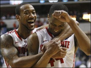 Former Libbey High School and current Ohio State Buckeye William Buford, right, walks off the court with OSU teammate David Lighty.
