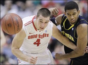 Ohio State guard Aaron Craft, left, and Michigan guard Darius Morris chase a loose ball.