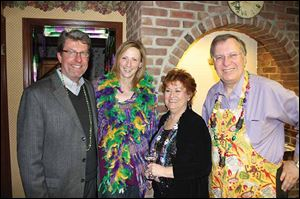 Scott Schell and Wendy Kromer-Schell, left, join Sharon and Michael Sordyl to celebrate Mardi Gras.