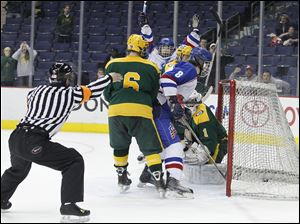 Toledo St. Francis de Sales player Matt Opblinger (11) raises his arms as his shot finds the back of the net to defeat Lakewood St. Edward in overtime at Nationwide Arena. Also on the play are St. Francis player Tyler Murphy (8) and St. Edward players Alex D'Angelo (6) and Jonathan Lacoste (1).