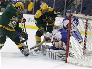 Toledo St. Francis de Sales goalie Thomas Kosinski (1) stops the shot of Lakewood St. Edward player Mick Bartholomew (4).