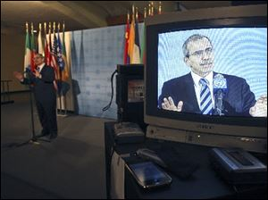 Lebanese Ambassador to the United Nations Nawaf Salam is seen on a television monitor Monday as he speaks to reporters afte