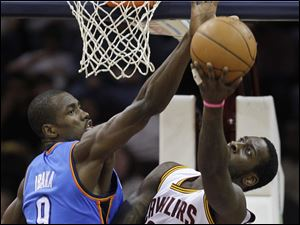 Oklahoma City's Serge Ibaka blocks the shot of J.J. Hickson. Hickson had 15 rebounds.