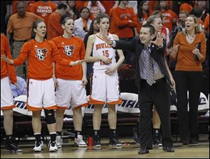 BGSU coach Curt Miller questions a push call by the ref during 2011 Mid-American Conference women's basketball final against Eastern Michigan at Quicken Loans Arena in Cleveland.
