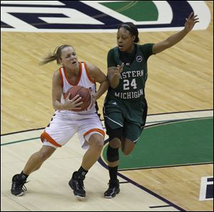 "BGSU's Tracy Pontius maneuvers around E. Michigan's Tavelyn James during 2011 Mid-American Conference women's basketball final at Quicken Loans Arena in Cleveland.  S2 S2pontius 3.26""x3.4"" black and white"