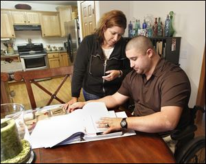 Cindy Parsons of Fostoria is glad her son, retired Army Sgt. Shane Parsons, is alive and at home after an explosion in Iraq injured him in 2006. She and others have quit their jobs to take care of wounded vets.