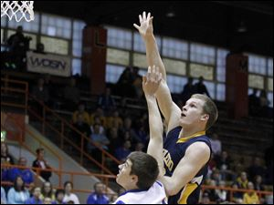 Toledo Christian's David Westmeyer takes a shot over Continental's Austin Sharp.