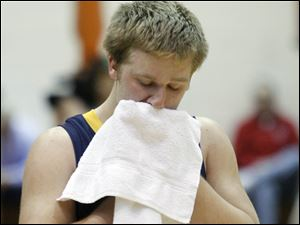 Toledo Christian's Luke Sims takes a moment to reflect after the loss.
