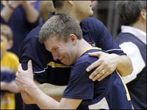 Toledo Christian's Tosh Whitlow hugs coach David McWhinnie after their team's loss to  Continental.