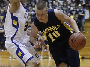Archbold's Garrett Morton (10) dribbles around  Ontario's Spencer Sheppard (33).