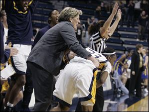 UT coach Tricia Cullop grabs Jessica Williams in celebration after Williams scored the go-ahead 3-pointer with 53 seconds left in the game.