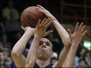 Archbold's Luke Kammeyer (24) jumps to take a shot over the arms of Ontario's Bryan Wendling (32).