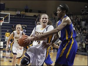 UT's Naama Shafir draws a foul from Delaware's Eva Riddick.