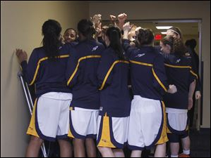 The University of Toledo women's basketball team huddles in the hallway before their WNIT game against Delaware.