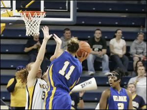 UT's Melissa Goodall prevents Delaware's Elena Delle Donne from tying the game with seconds left on the clock.