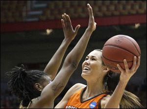 Bowling Green State University guard Lauren Prochaska (2) goes to the net against  Georgia Tech's Chelsea Regins (32).