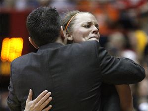 Bowling Green State University guard Tracy Pontius (5) hugs head coach Curt Miller during the final seconds of their NCAA first round game against Georgia Tech.