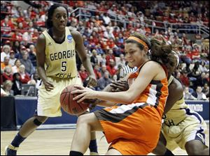 Bowling Green State University guard Chrissy Steffen (21) battles Georgia Tech's Tyaunna Marshall (15) for the ball.