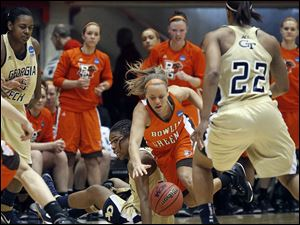 Bowling Green State University guard Tracy Pontius (5) steals the ball from Georgia Tech's Deja Foster (23).