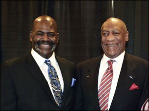 Toledo Mayor Mike Bell, left, stands with comedian Bill Cosby, who spoke to 750 with the Greater Toledo Urban League is to lead a morning rally.