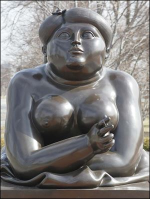 Botero's 'Smoking Woman' welcomes visitors outside the Toledo museum.