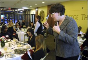 Bonnie Bland of Aladdin Food Management Services teaches students how to make a good impression during business meals.