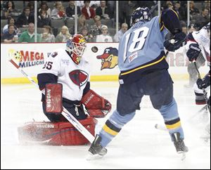 South Carolina goalie Shane Owen, left, stops Toledo's Randy Rowe in a 3-1 Walleye loss. Owen frustrated Toledo with 35 saves.