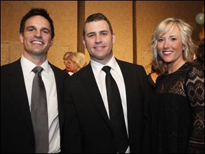 From left, Tony Jagodzinski with Scott and Sarah Weghorst.