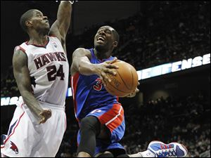 Detroit Pistons' Rodney Stuckey (3) goes to the basket as Atlanta Hawks forward Marvin Williams (24) defends Sunday.