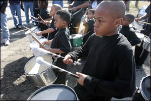 Jameion Capps, 11, and others with the JJ Express Drill and Drum corps. perform at the rally with Bill Cosby at Smith Park.
