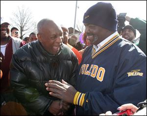 Bill Cosby and Mayor Mike Bell share a laugh outside the Mott Branch Library on Dorr Street. Mr. Bell obeyed Mr. Cosby's request to speak about libraries' importance.