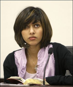 Rifqa Bary listens to the judge during a hearing to settle disputes between Bary and her parents in Columbus last March.