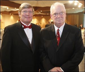 Board chairman David Lindstrom, left, and event chairman Buzz Hermann.